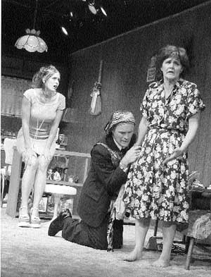 Kittson O'Neill (left), Ames Adamson and Kathleen Goldpaugh in a scene from Maggie Rose at New Jersey Repertory Company, Long Branch.